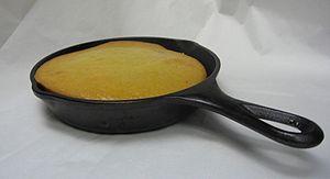 English: Cornbread in a cast iron skillet.