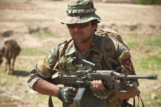 An Afghan National Army special forces soldier returns from a mission in which he helped Afghan Local Police members (ALP) build a checkpoint April 3, 2013, in Helmand province, Afghanistan 130403-M-BO337-220