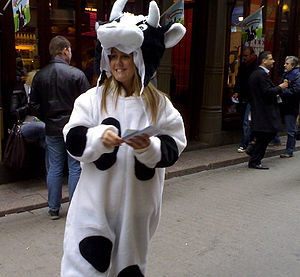 Girl in cow costume promoting Free Cone Day ou...