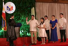 Duterte takes his oath of office as the 16th President of the Philippines before Associate Justice Bienvenido L. Reyes at Malacañang Palace while his children look on, June 30, 2016.