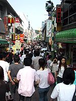 A crowded street in Japan, a country with a high population density.