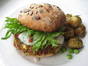 Veggie burger with zucchini/feta/pea patty.