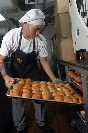 Seaman Mark Andaya prepares fresh rolls for th...