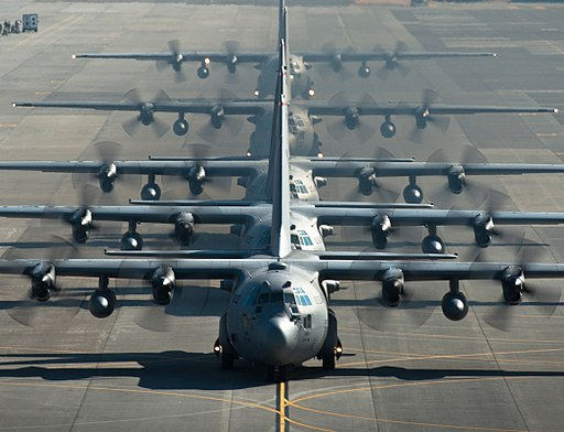 Five U.S. Air Force C-130 Hercules cargo aircraft line up before taking off during readiness week at Yokota Air Base, Japan, on Feb 130221-F-WE773-983
