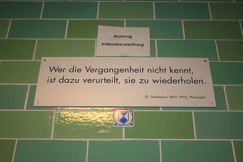 Santayana's aphorism about those ignorant of history, on a plaque in a German subway