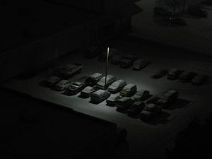 A photo of a light in a dark snowy night