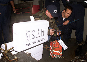 U.S. Navy Lt. j.g. Jason S. Hall (right) watch...