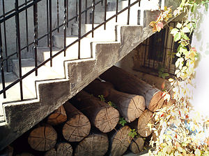 Firewood under stairs