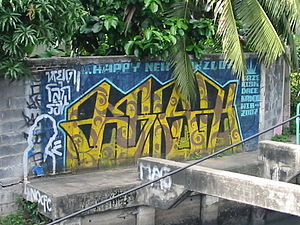 Graffiti in Bangkok, Thailand (Tag on upper le...