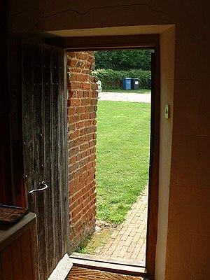 English: Wooden door Looking out of the door o...