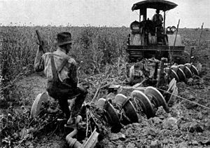 English: Plowing an Alfalfa field by tractor, US