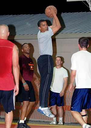 Barack Obama rebounding the ball in a game of ...