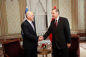 Greece's Prime Minister George Papandreou (L) ...