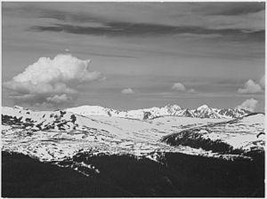 English: View at timberline, dark foreground, ...