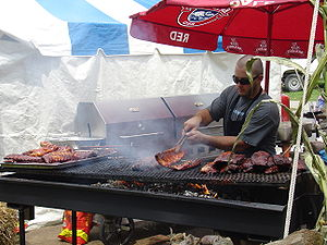 A cook barbecues ribs at the 2006 Rib-Fest in ...