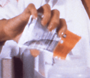 English: pouring of an ORS sachet into a bottle