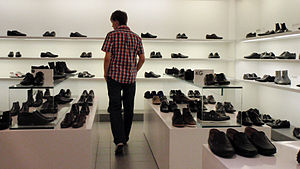 English: A man browsing the shoe department in...