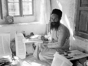 Orthodox Jewish scribe, Shlomo Washadi, writin...