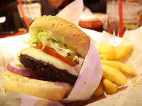 A burger with fries from Red Robin Go...