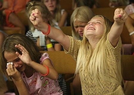Sunday School kids worshiping