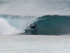 Bodyboarder riding in a tube