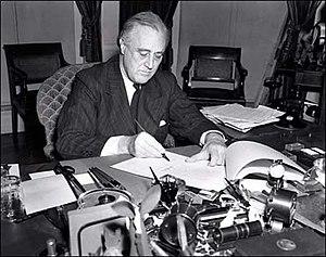 U.S. President Franklin D. Roosevelt signs the...