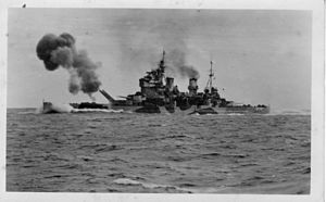 HMS Anson firing guns