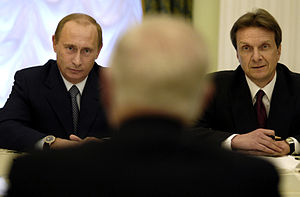 Russian President Vladimir Putin, left, speaks...