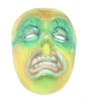 English: A translucent Halloween mask in the f...