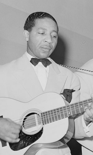 Lonnie Johnson playing in Chicago, 1941. Origi...