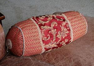 A typical throw pillow (cushion) found in a su...