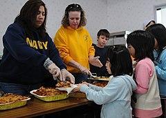 US Navy 110327-N-MU720-031 Volunteers erve food to children at the Biko-en Children's Care House