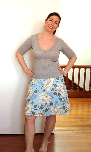 English: An A-line skirt, with top.