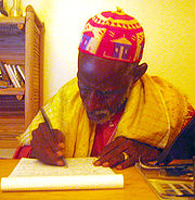 A Mali man writes an article for the Fula language Wikipedia in the Geekcorps Mali headquarters.