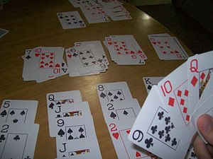 English: Playing Crapó - card game.