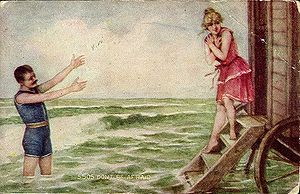 Man and woman in swimsuits, ca. 1910; she is e...