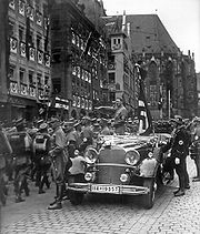 Parade of SA troops past Hitler. Nuremberg, November 1935.