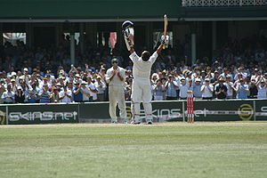 Sachin Tendulkar celebrates his century agains...