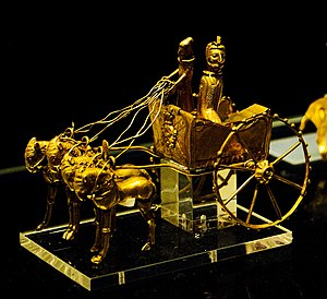 A gold horse drawn chariot model from the Oxus...