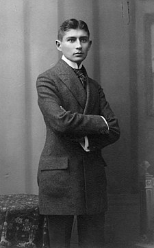 Black-and-white photograph of Kafka as a young man with dark hair in a formal suit
