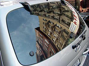 New York City architecture reflected in a car ...