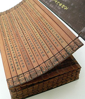 A Chinese bamboo book, open to display the bin...