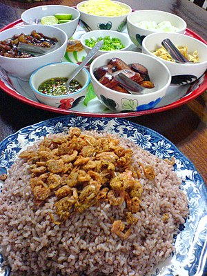Khao-kluke-kapi is a frie rice dish made with ...