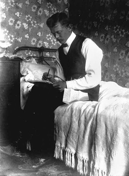 Intimate portrait of a man writing a letter, 1900-1910