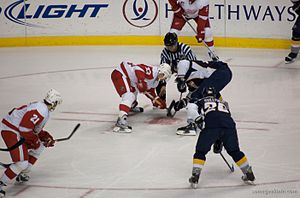 Face off Red Wings (white and red) versus Pred...