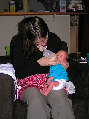 English: A baby being fed using a Haberman Fee...
