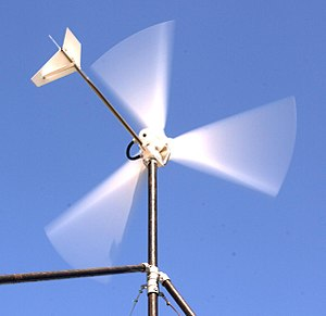 This wind turbine charges a 12 V battery to ru...