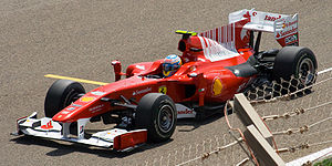 Fernando Alonso driving for Ferrari during a p...