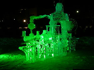 Ice sculpture of a train, lit at night. Taken ...