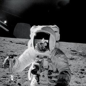 Apollo 12 astronaut Alan Bean holds a special ...